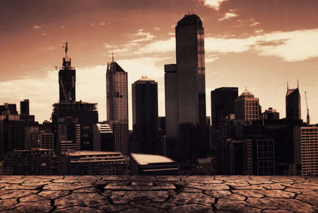 industry moody: cracks texture with the city background Stock Photo