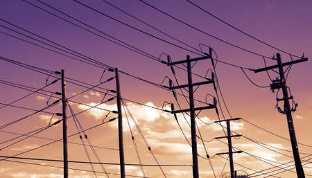 power cables: power station cables on sunset Stock Photo