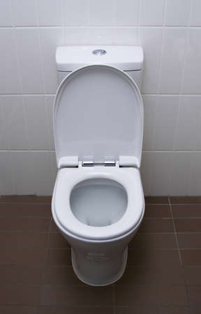 white home toilet closeup photo