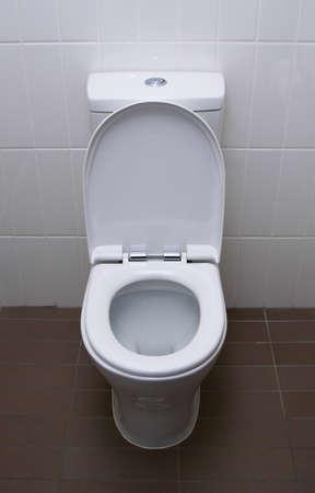 white home toilet closeup photo