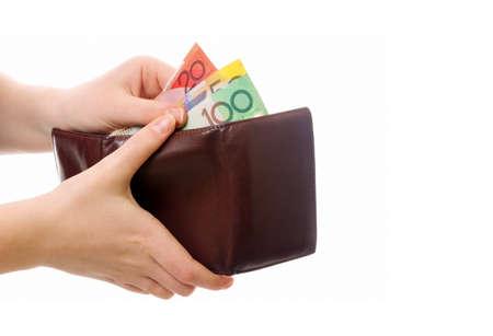 australian money: female hands holding wallet with australian money