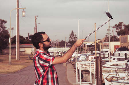 man with beard taking selfie picture photo