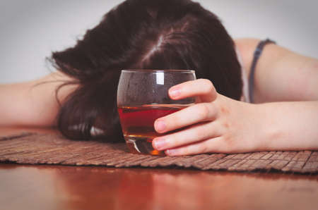 addiction alone: woman with alcohol addiction concept,shallow DOF
