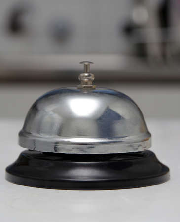 hospitality staff: ring bell closeup on table Stock Photo