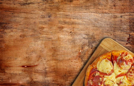 pizza on the wooden table,top view photo
