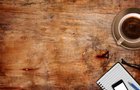 top view of coffe ,notepad with pen and phone Stock Photo