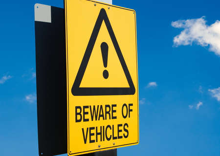 driving conditions: beware of vehicles road sign closeup