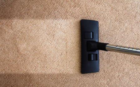 closeup of the vacuum on the carpet
