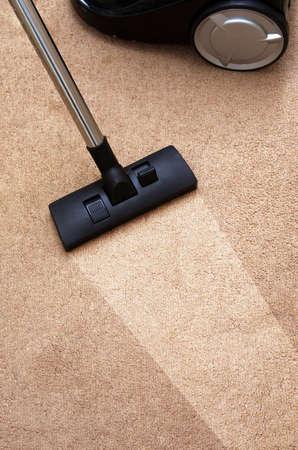 clean floor: closeup of the vacuum on the carpet