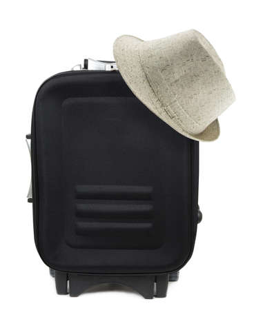 piece of luggage: travel suitcase and hat over white