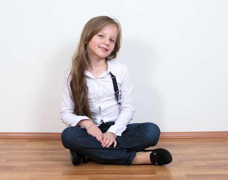 sitting pretty: pretty girl portrait sitting on floor