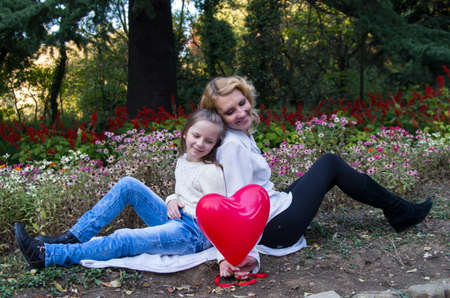 baloons: mother and daughter in the autumn park with baloons