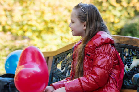 baloons: pretty girl in the autumn park with baloons