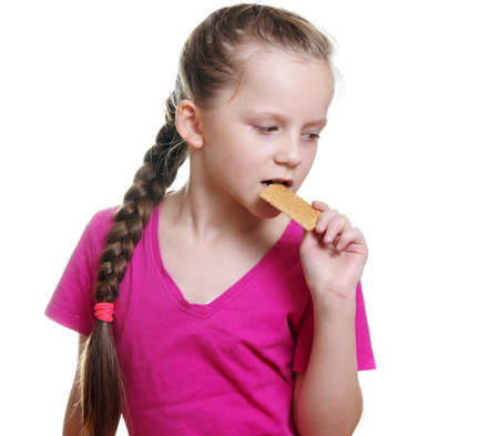 bisquit: pretty girl eating  bisquit