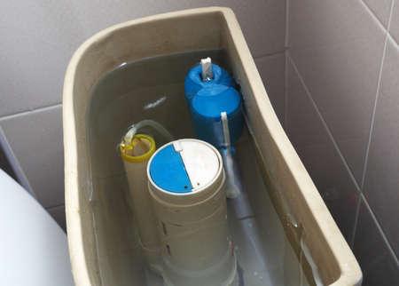 old toilet tank pump closeup