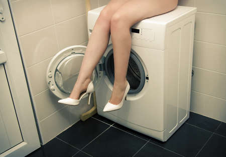 dirty blond: girl in underwear in the bathroom sitting on washing machine