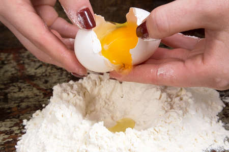 breaking: breaking the egg into the dough