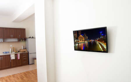 closeup of the tv screen in apartment with city view