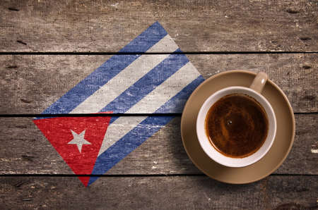 cuba flag: Cuba flag with coffee on table. top view Stock Photo