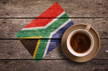 South Africa  flag with coffee on table. top view Standard-Bild