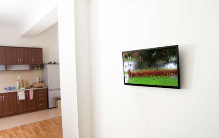 drop ceiling: closeup of the tv screen in apartment with picture Stock Photo
