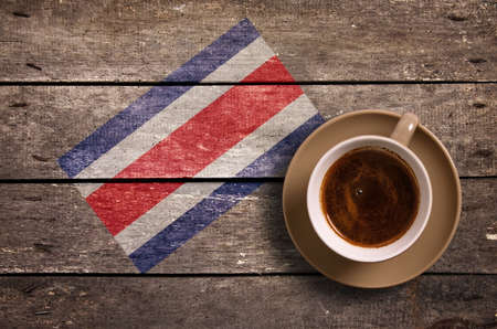 Costa Rica flag with coffee on table. top view Stock Photo