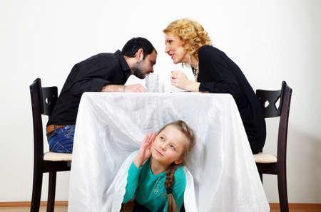 little girl listening to adults secrets