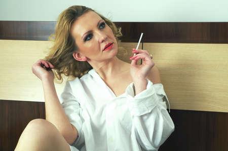 smoking women: beautiful woman in the bedroom