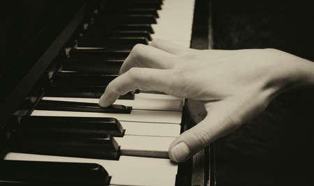 piano closeup: playing the piano closeup, toned picture Stock Photo