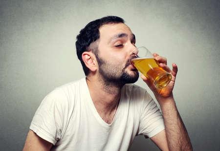 funny bearded man: funny bearded man drinking beer