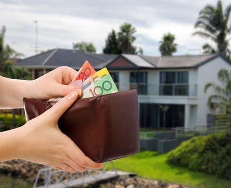 australian money: australian money in wallet on real estate background