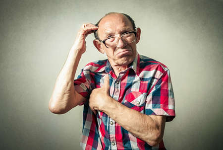 funny people: portrait of the funny senior man thinking