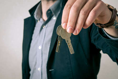 accommodation broker: Man giving the new keys Stock Photo