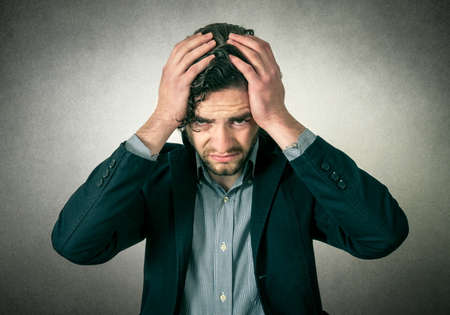 head pain: Bearded man thinking or has head pain Stock Photo
