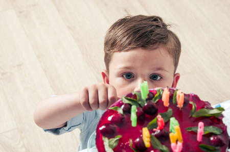 Little boy with the birthday cake Stock Photo