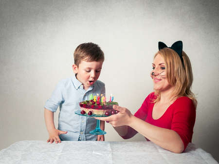 Little Boy With Mum And The Birthday Cake Stock Photo