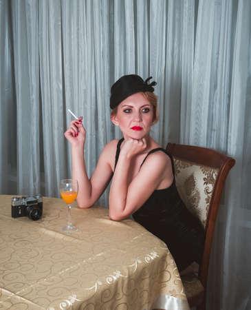 Vintage woman portrait with cigarette Stock Photo