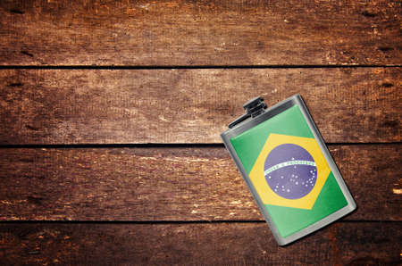 Alcohol flask on the table with flag, Stok Fotoğraf