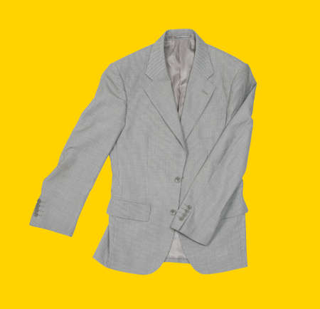 Suit on the yellow baclground Stock Photo