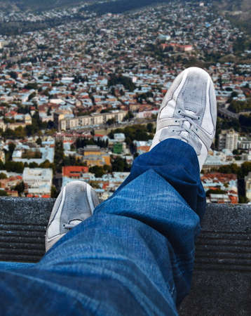 Man standing on the edge Stock Photo