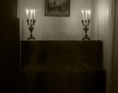 Ghost woman in room with candles