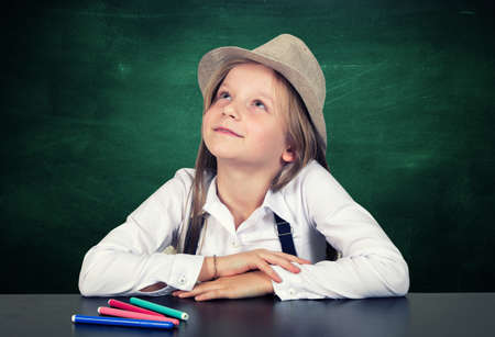 Young girl portrait with the school chalkboard Stock Photo
