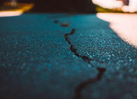 Closeup of the cracks in asphalt Imagens - 119872589