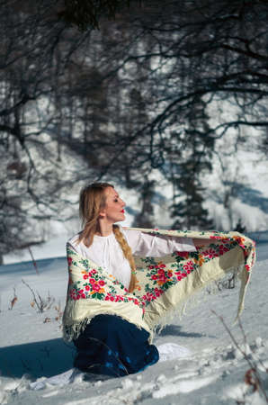 Woman portrait in the snow. Russian style