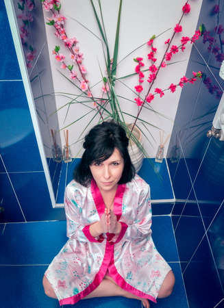 Woman in bathroom. Pray. Geisha style