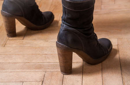 Female boots on the floor