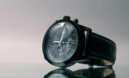 Elegant wrist watch closeup on dark