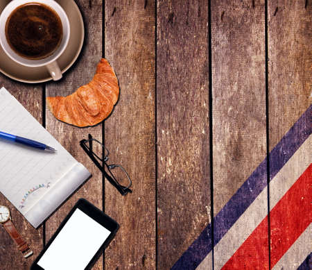 Coffee with the notepad and phone