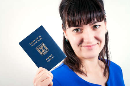 Israel passport in the hand of woman