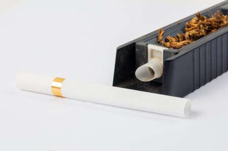 Tobbaco cigarette making machine on the white Stock fotó